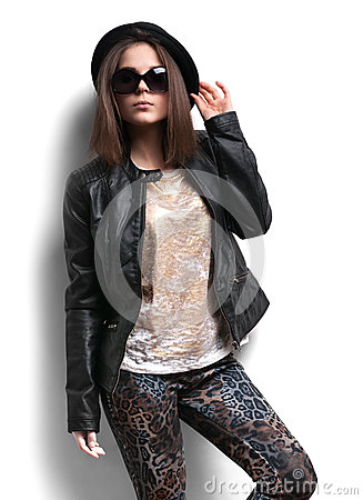 Girl in a leather jacket and black hat