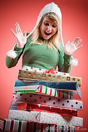 Caucasian girl receiving christmas gifts