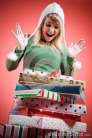 Caucasian girl receiving christmas gifts