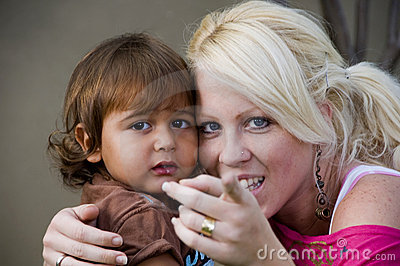 Caucasian lady telling her child to look at camera