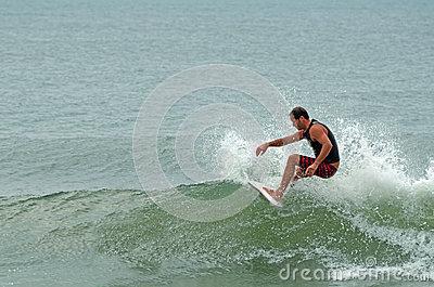 Caucasian Male Surfing Wrightsville Beach, NC Editorial Photo