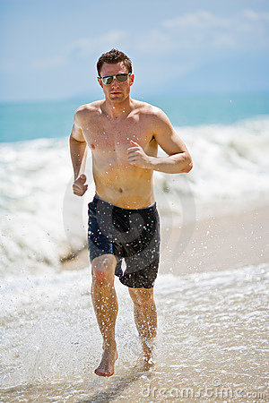 Caucasian man running on the beach