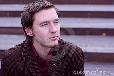 Caucasian man sad or dreaming expression by stairs