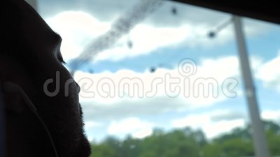Caucasian man sleeping in a train. View to the window. Close up.Caucasian man sleeping in a train. View to the window. Professional shot in 4K resolution. 02 stock footage
