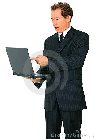 Caucasian Senior Businessman Point At Laptop