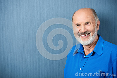 Caucasian senior teacher smiling at camera