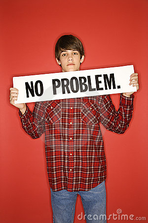 Caucasian teen boy holding no problem sign.