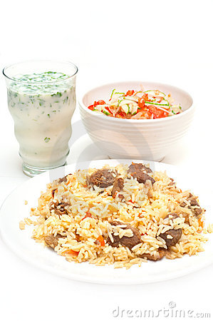 Caucasian traditional pilaf, ayran and salad.