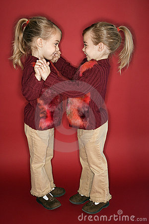 Caucasian twin girls.