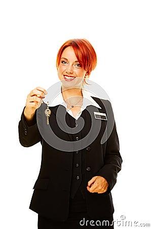 Caucasian woman as hotel worker offering key