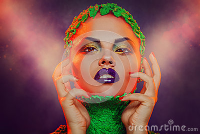 Caucasian woman with creative makeup in studio