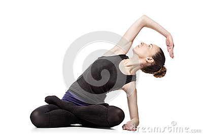 Caucasian woman exercising pilates