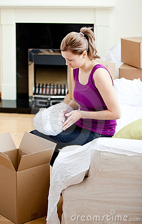 Caucasian woman having a break between boxes