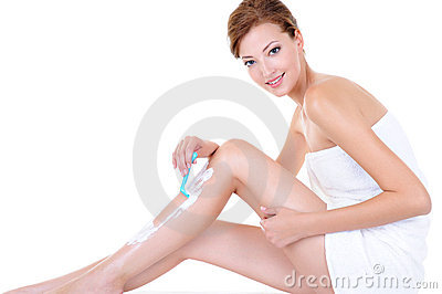 Caucasian woman shaving legs with razor