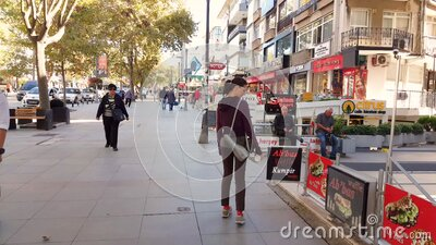 Caucasian woman walking alone near stores in Bagdat Street at the weekend. Istanbul, Turkey - October 05, 2018: Back view of a young Caucasian brunette woman in stock video
