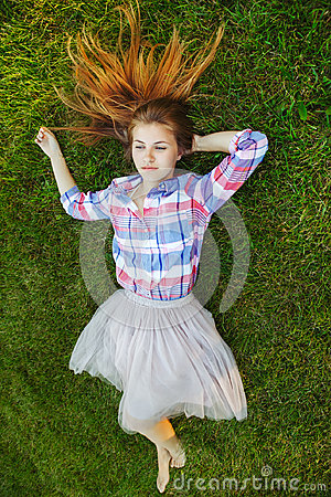 Free Caucasian Woman With Red Messy Hair Lying On Grass In Plaid Shirt And Tulle Tutu Skirt. View From Above Top Royalty Free Stock Photos - 95926718