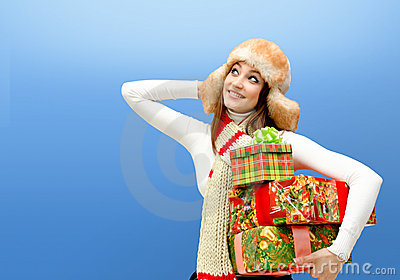 Caucasian young woman with christmas gifts