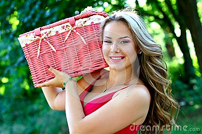 Caucasian young woman with pink vintage basket
