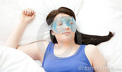 Caucasian young woman sleeping with an eye mask