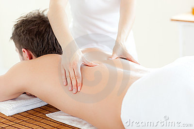 Caucsasian young man having a back massage