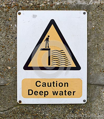 Caution deep water sign on wall