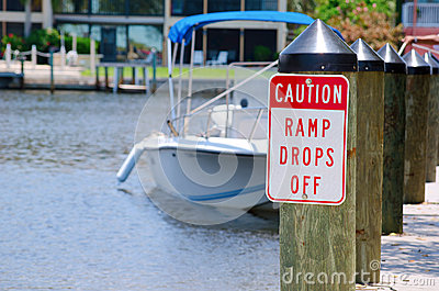Caution sign at boat ramp