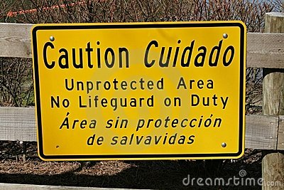 Caution Sign At Lake