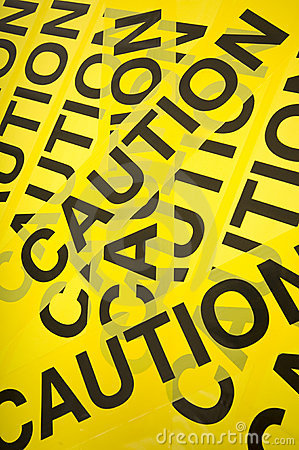 Yellow barrier tape with the word Caution, great background. Keywords: