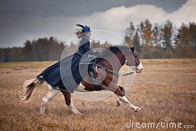 Cavalo-caça com as senhoras no hábito de equitação Imagem Editorial