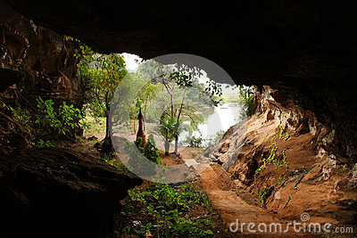 Cave with river and a buddhist temple inside