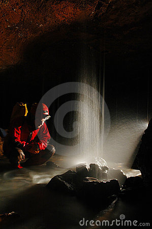 Free Caver With A Small Waterfall Stock Image - 21836981