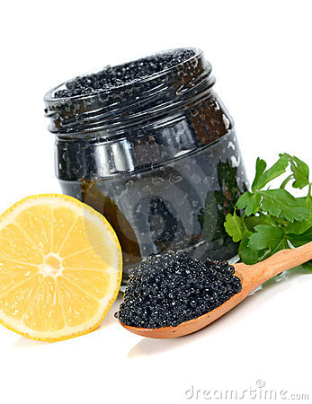 Caviar black in a glass jar with lemon and parsley