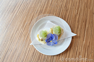 Caviar dessert garnished with purple flower