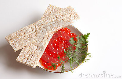 Caviar of a salmon on a saucer and small loafs