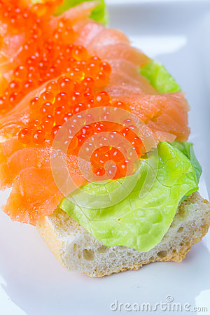 Caviar and smoked salmon sandwich
