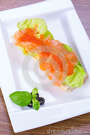 Caviar and smoked salmon sandwich