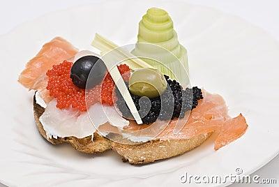 Caviar and smoked salmon on a toast.