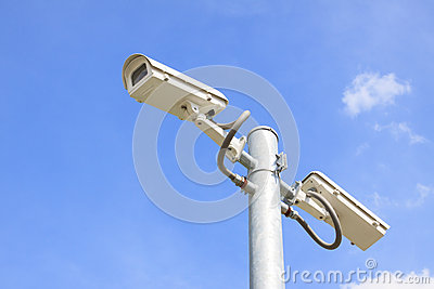 Cctv camera and blue sky white clouds