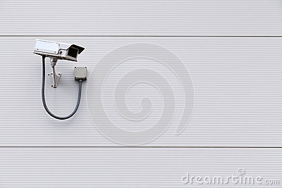 CCTV camera on wall with copy space