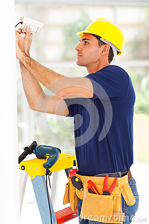 Free Cctv Technician Adjusting Camera Stock Image - 30284291