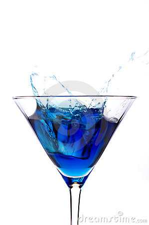Ce splashing into a blue martini