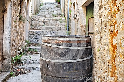 Cedar barrel in a narrow street