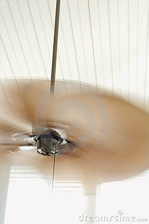 Ceiling fan with motion blur.