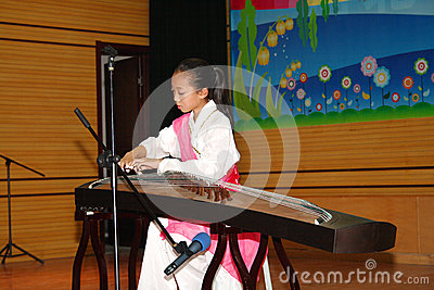 Celebrate Children s Day:playing guzheng Editorial Photo