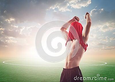 Celebrating sportsman or soccer football player
