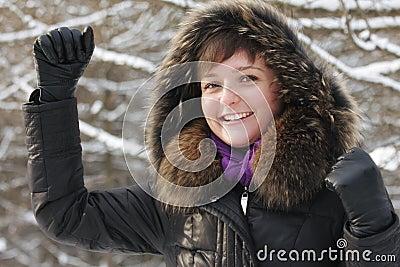 Celebrating woman in frosty day