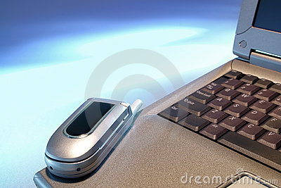 Cell Phone on Business Laptop over Open Blue Space
