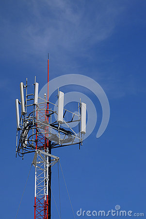 Cell site tower with blue sky.