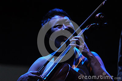 Cello player performs live on the stage Editorial Stock Image