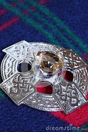 Celtic brooch on tartan